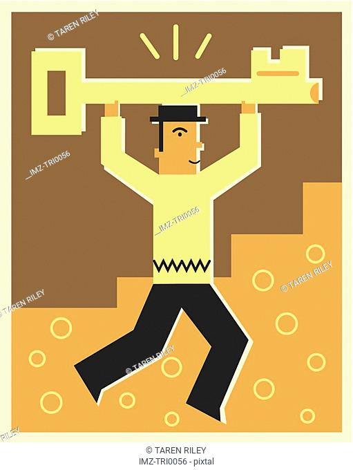 Man holding a key above his head