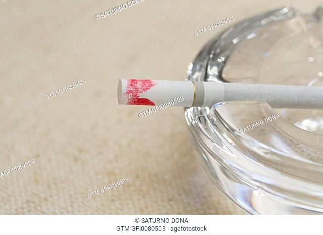 cigarette with lisptick mark on ash tray