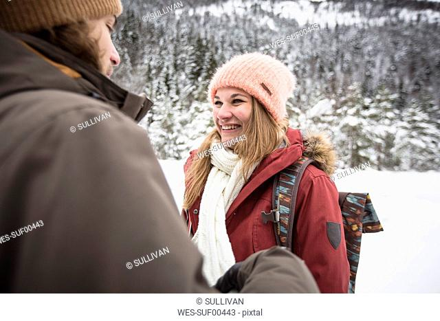 Happy couple on a trip in winter