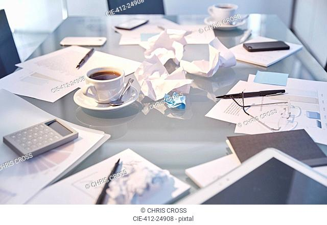 Messy table in conference room of modern office