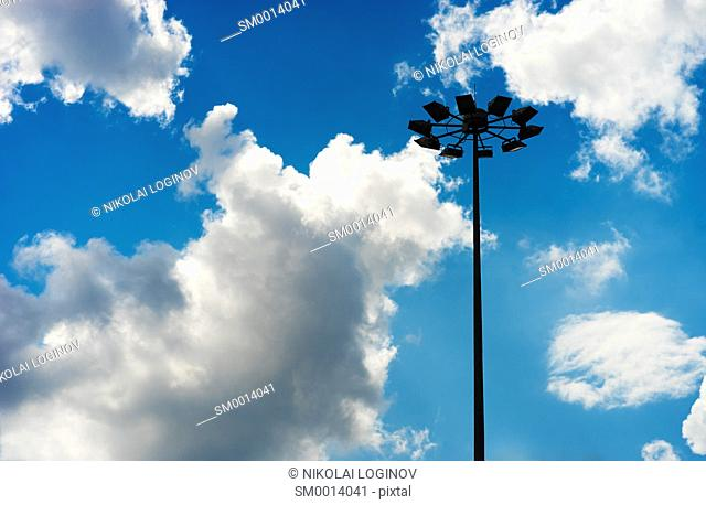 Horizontal city lamp on dramatic clouds background