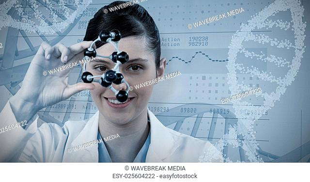 Composite image of portrait of female scientist holding molecular model