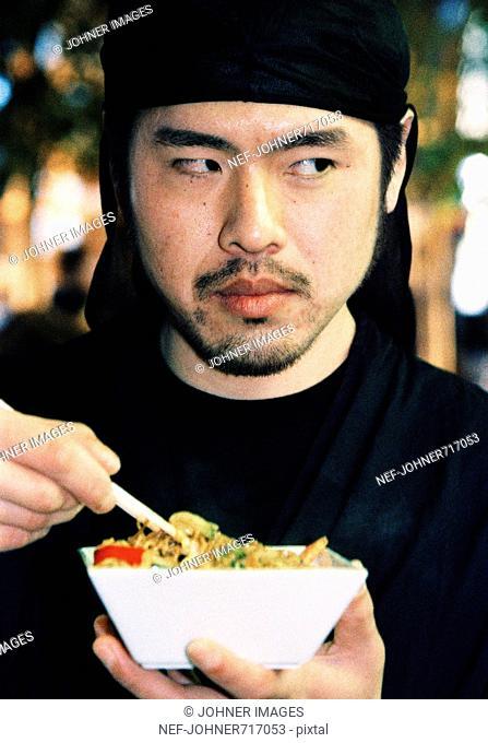 Man eating noodles, Spain