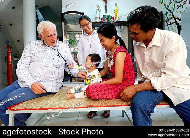 French NGO Chaine de l'Espoir. Children's pavilion. Child suffering of heart disease. Medical consultation. Pr Alain Deloche. Ho Chi Minh City