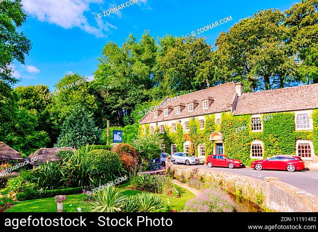 BIBURY, UNITED KINGDOM - AUGUST 08: This is the Swan hotel in Bibury town in the Cotswolds area. This is one of the main hotels in the area where many tourists...
