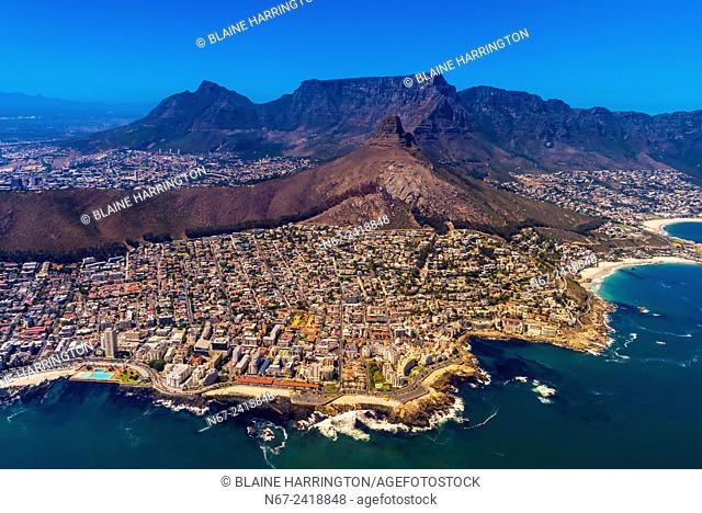 Aerial view of coastline of Cape Town with Lion's Head and Table Mountain in background, South Africa