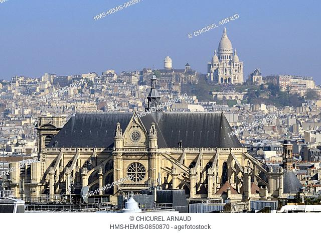 France, Paris, Saint Eustache church and Sacre Coeur of Montmartre basilica in the background