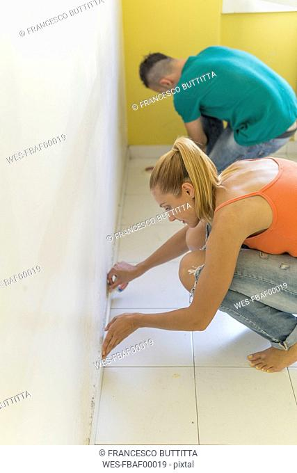 Couple preparing room at new home for renovation