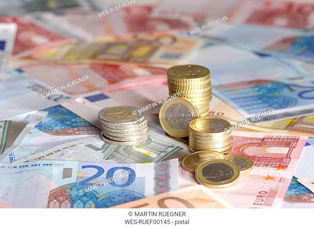 Euro notes and coins, close up