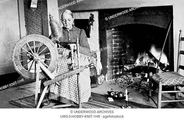Sugar Hill, New Hampshire: c, 1900.A woman spinning wool by her fireplace