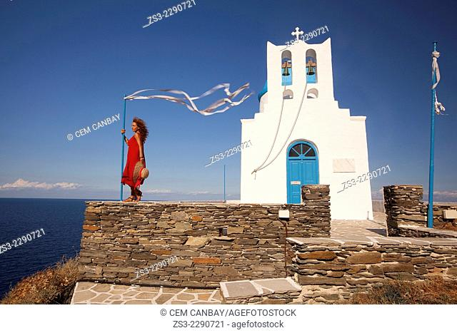 Woman in front of the Seven Martyrs chapel in Kastro, Sifnos, Cyclades Islands, Greek Islands, Greece, Europe