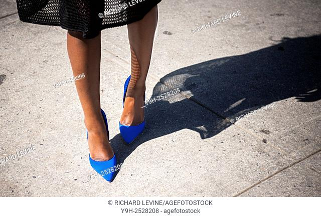 A fashionista shows off her Just Fab brand shoes after a show at Spring 2016 Fashion Week at Skylight Clarkson Square in Soho in New York on Friday