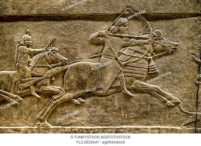 Assyrian relief sculpture panel of Ashurnasirpal lion hunting. From Nineveh North Palace, Iraq, 668-627 B. C. British Museum Assyrian Archaeological exhibit no...