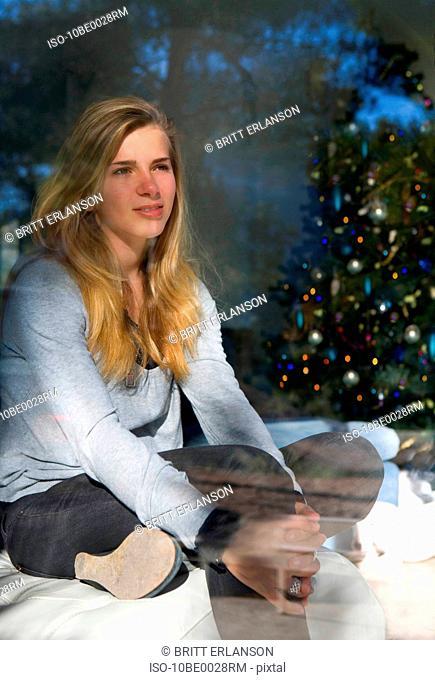 Teen girl looks thinking at christmas