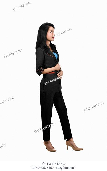 Image of asian business woman standing while looking up posing isolated over white background