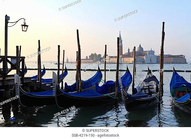 Gondolas in a canal with a church in the background, Church Of San Giorgio Maggiore, Venice, Veneto, Italy