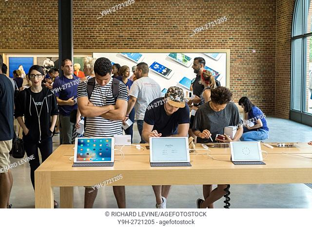 Apple enthusiasts descend on Williamsburg, Brooklyn in New York for the grand opening of Apple's first store in Brooklyn