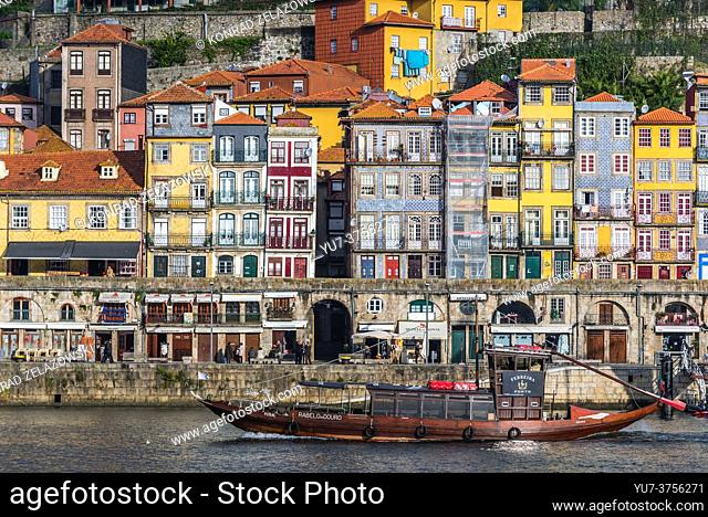 Row of buildings on Cais da Ribeira street in Ribeira District on the Douro riverfront in Porto city, Portugal