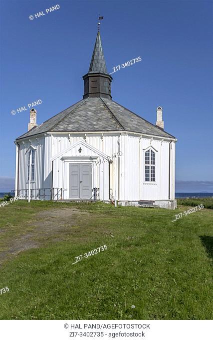 entrance side of octagonal historical church at Artic village, shot under bright summer light near Dverberg, Andoya, Vesteralen, Norway