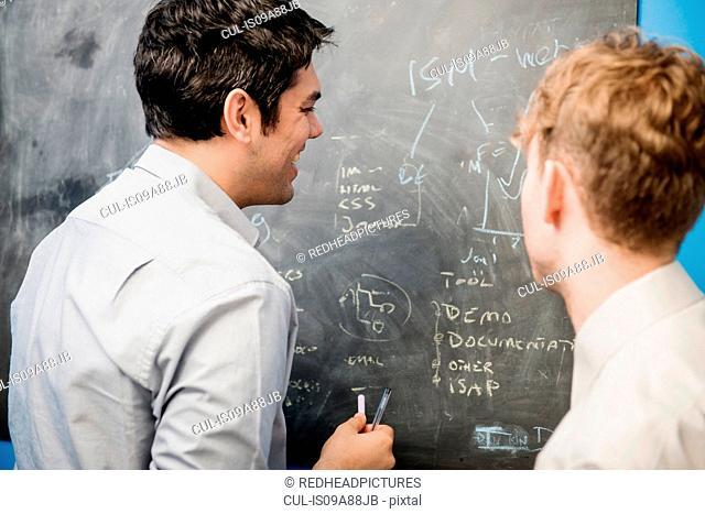 Businessmen at blackboard