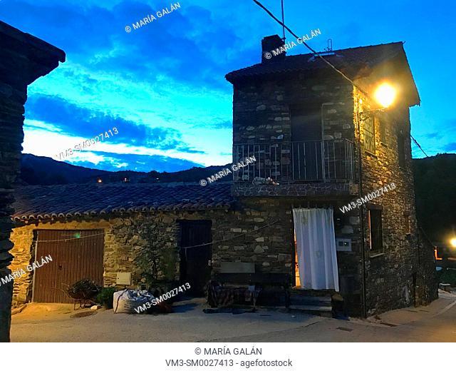 House, night view. Puebla de la Sierra, Madrid province, Spain