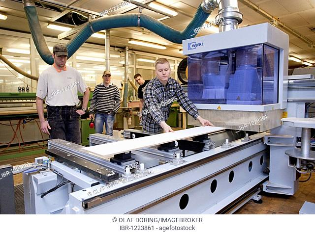 Master Craftman students using a CNC milling machine, Master course for carpentry, Master Craftman School of the Chamber of Small Industries and Skilled Trades