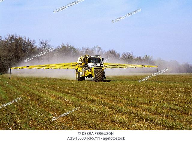 Agriculture - A Terra-gator applies preplant burndown herbicide to a field of weeds and cotton stubble in Spring prior to no-till planting / MS