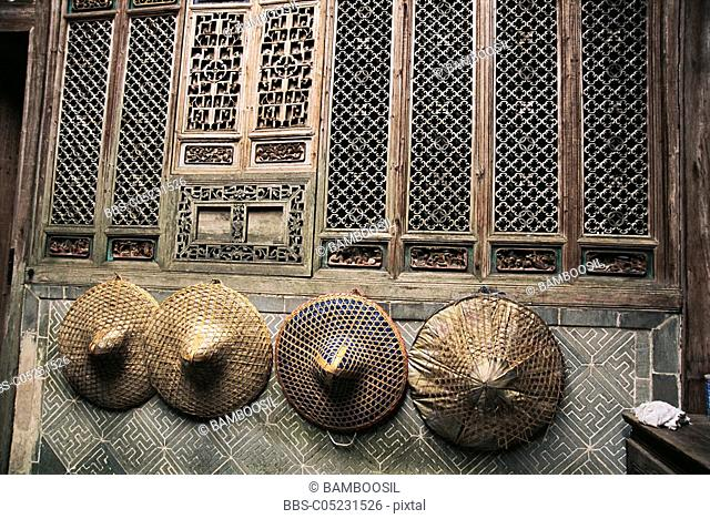 Hats hanged on wood carved wall, ancient common people residence of Ming and Qing dynasty, Lu Village, Yi County, Anhui Province of People's Republic of China