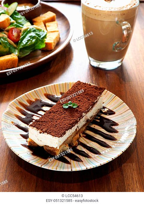 Tiramisu cake on a woodend table