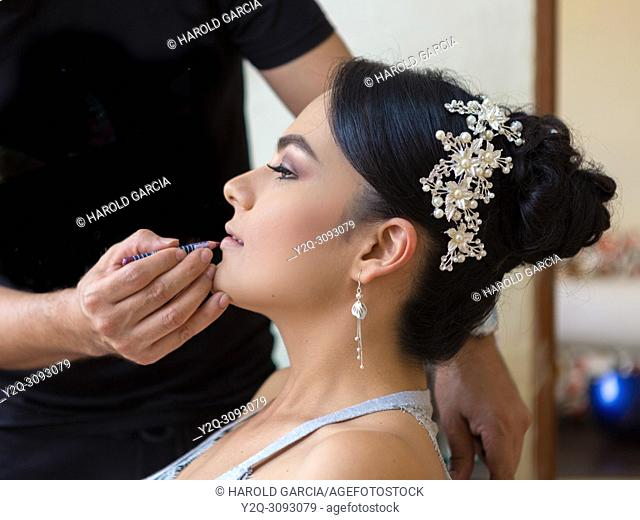 Final make up touch for a bride