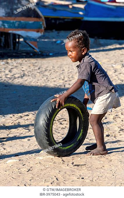 Malagasy child playing with a used tire, Morondava, Toliara province, Madagascar