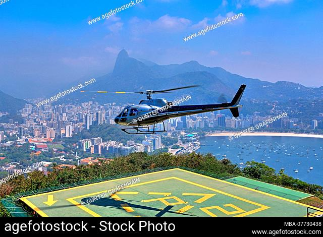 Helicopter landing field on the mountain Urca with view to the part of town of Botafogo and Corcovado 710 m, Rio de Janeiro, Brazil
