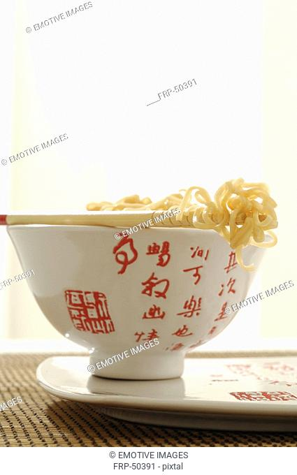 Asian bowl, chopsticks and noodles