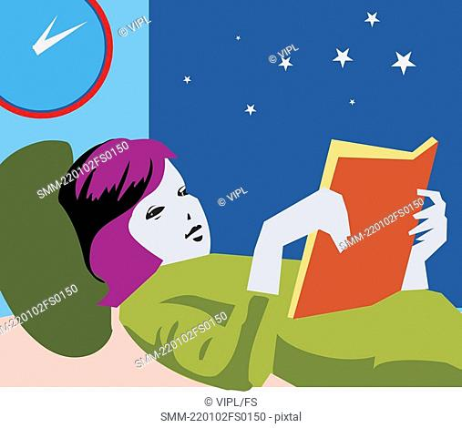 Girl reading book while lying on bed