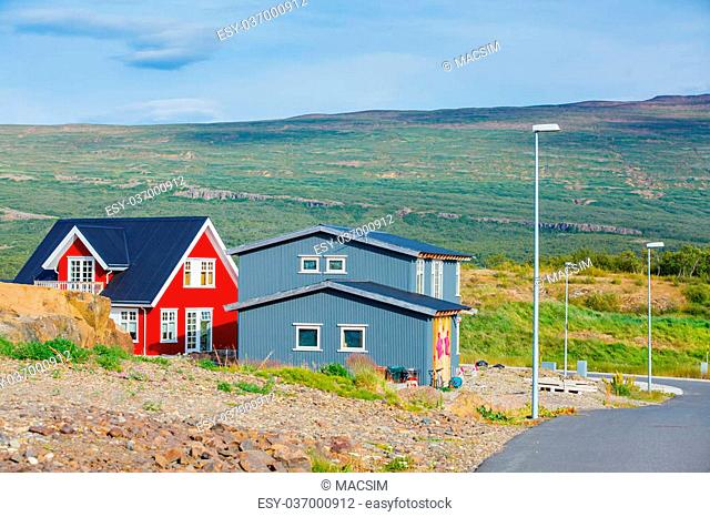 Beautiful house in Iceland. Mountains in background