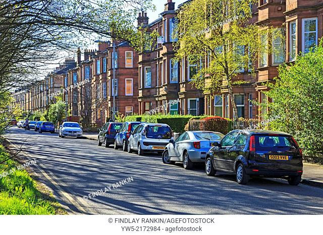 Clifford Street, Govan Glasgow showing a row of traditional red sandstone tenements, common in Glasgow, Scotland, UK