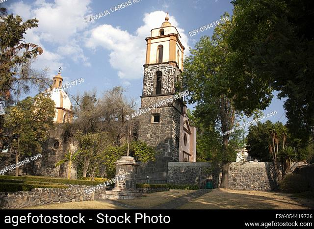 View of the towers and parts of the dome of the former Culhuacán convent in Mexico City wonders among the city