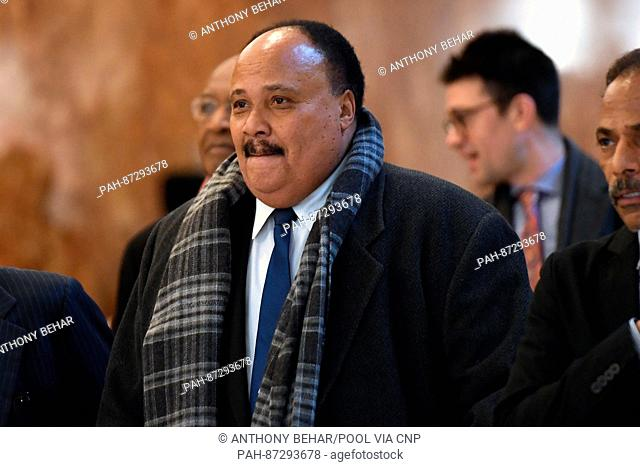 Martin Luther King III (c) is seen arriving in the lobby of the Trump Tower in New York, NY, on January 16, 2017 Credit: Anthony Behar / Pool via CNP - NO WIRE...