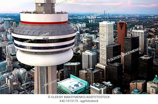 Aerial view of a CN tower in front of Toronto downtown sity scenry at dusk, Ontario, Canada  CN Tower is a photo realistic 3D illustration