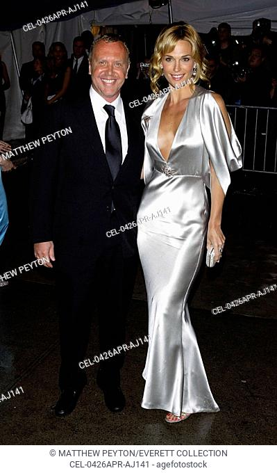 Model Molly Sims and Michael Kors arrive at the Costume Institute Party of the Year at the MET April 26, 2004 in New York City