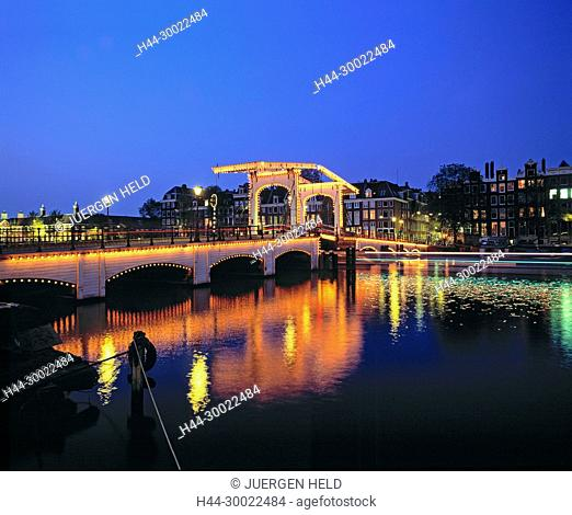 Amsterdam,Magere Brug,famous old drawbridge at dawn over river Amstel