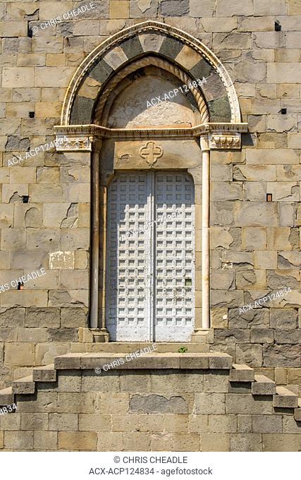 Church side door at Chiesa de San Giovanni Battista, Riomaggiore, a village and comune in the province of La Spezia, situated in a small valley in the Liguria...