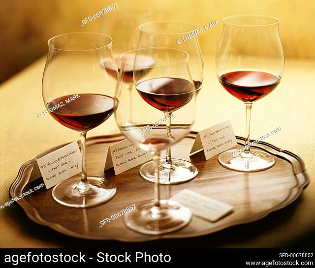 Five Glasses of Red Wine on a Tray for Wine Tasting, One Empty