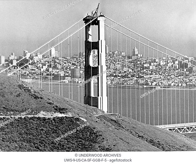 San Francisco, California: April 26,1937.One more month and the Golden Gate Bridge will be open. Here is the view from the Marin Headlands with the city in the...