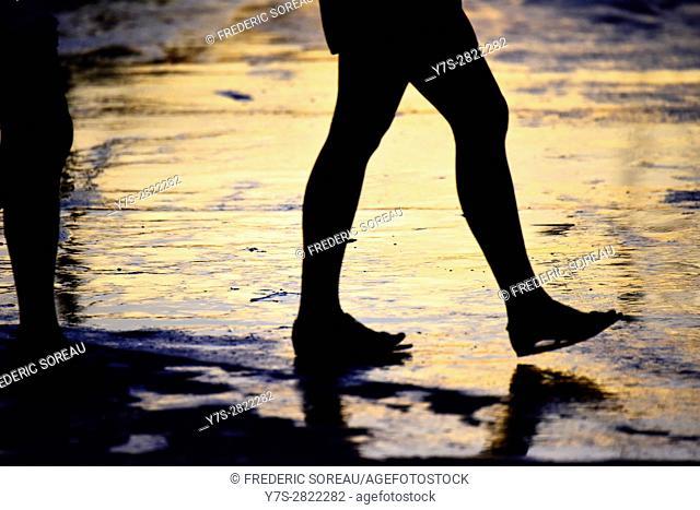 Silhouette of woman walking on street of Trinidad, Cuba