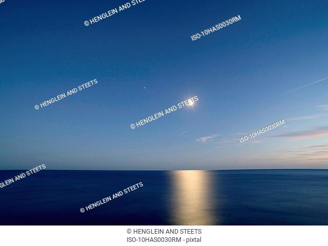 The sea, moon, stars in Tuscany at night