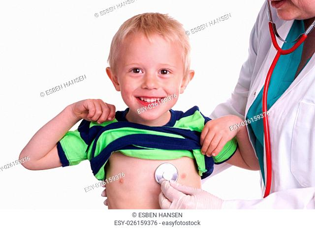 Doctor examines a young child. The doctor examines the child and listening to the heart and lungs with her stethoscope. He helps doctor by lift his shirt up so...