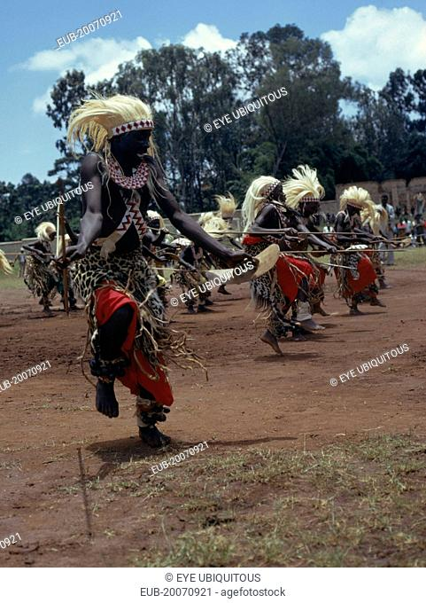 All male traditionally adorned Tutsi intore dancers characterised by coordinated drilling dances reflecting the Tutsi warrior tradition