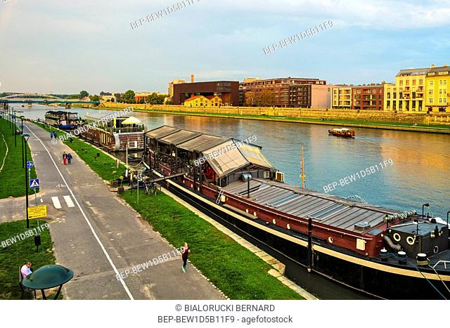 Krakow, Lesser Poland / Poland - 2018/09/08: Cracow Old Town, panoramic view of the newly renovated historic Podgorze district by the Vistula river