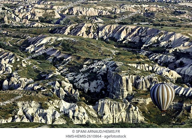 Turkey, Nevsehir, Cappadocia, Goreme, listed as World Heritage by UNESCO, Goreme National Park, overflight of Cappadocia with multicolored balloons (aerial...